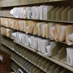 7 tier high open shelf TAB brand filing system with postal shelving, Single and double siding sections available. Over 100 Leneal feet available. Call for pricing.